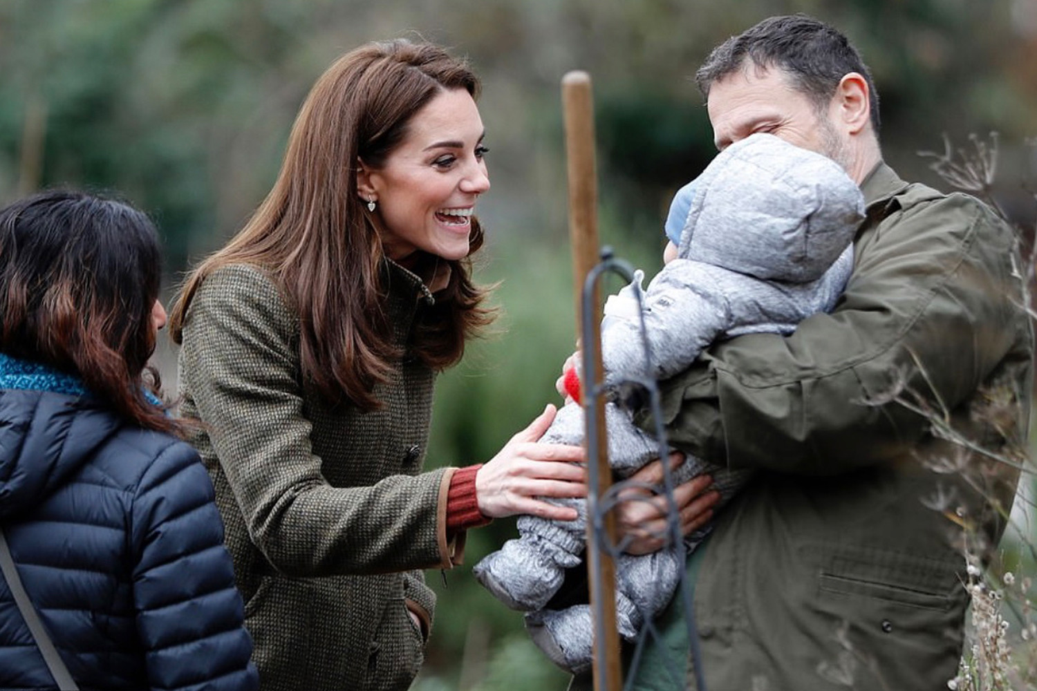 Kate greets a young garden visitor.
